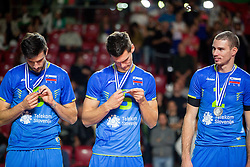Mitja Gasparini #6 of Slovenia, Alen Sket #5 of Slovenia and Alen Pajenk #2 of Slovenia celebrate at trophy ceremony after placed 2nd after volleyball match between National teams of Slovenia and France at Final match of 2015 CEV Volleyball European Championship - Men, on October 18, 2015 in Arena Armeec, Sofia, Bulgaria. Photo by Vid Ponikvar / Sportida