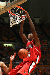 02 January 2004  Marcus Arnold hangs on after completing a jam. Illinois State University ties up The Fightin Illini in regulation but fails to top the Big 10 team in overtime. Action took place at the Assembly Hall on the University of Illinois Campus in Champaign - Urbana Illinois.