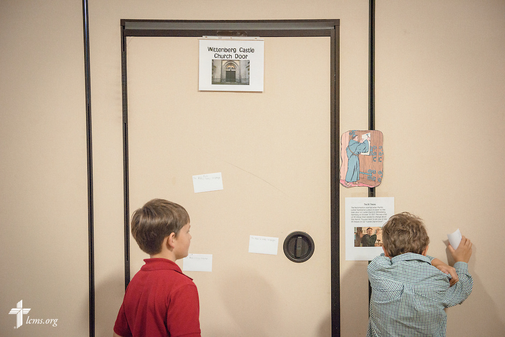 Students pin statements from Martin Luther's 95 Theses on the wall, renamed the Wittenberg Castle Church door for this particular classroom activity celebrating Reformation Day,  on Friday, Oct. 28, 2016, at First Immanuel Lutheran School in Cedarburg, Wis. LCMS Communications/Erik M. Lunsford