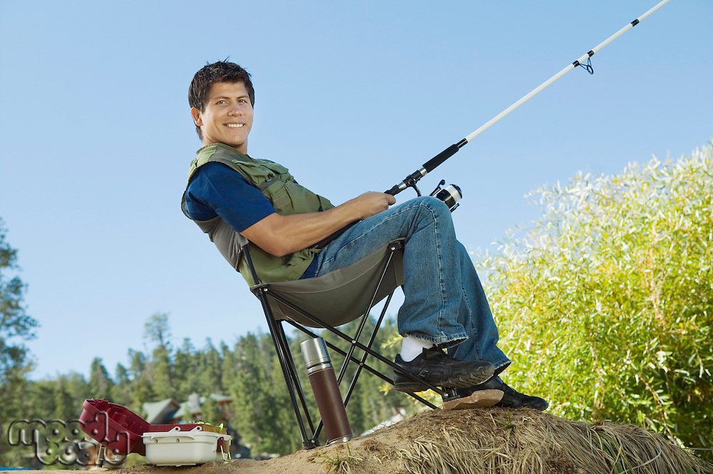 Man Fishing in Collapsible Chair