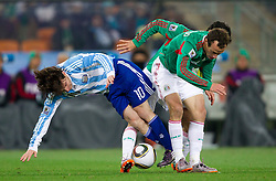 Lionel Messi of Argentina vs  Gerardo Torrado of Mexico during the 2010 FIFA World Cup South Africa Round of Sixteen match between Argentina and Mexico at Soccer City Stadium on June 27, 2010 in Johannesburg, South Africa. (Photo by Vid Ponikvar / Sportida)