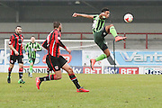 Lyle Taylor of AFC Wimbledon jumps to get the ball during the Sky Bet League 2 match between Morecambe and AFC Wimbledon at the Globe Arena, Morecambe, England on 12 March 2016. Photo by Stuart Butcher.