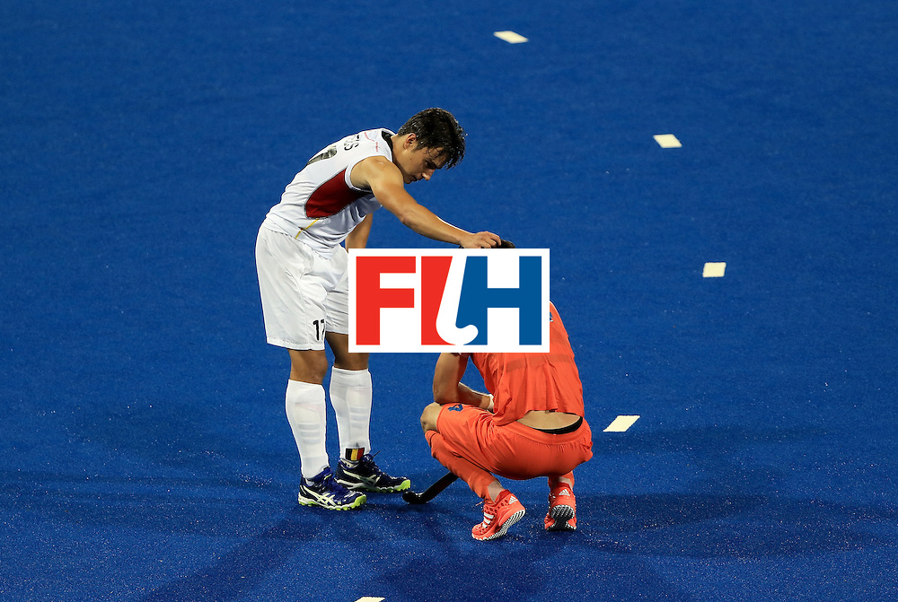 RIO DE JANEIRO, BRAZIL - AUGUST 16:  Thomas Briels #17 of Belgium consoles Robert Kemperman #14 of the Netherlands following a 3-1 victory in a semifinal match on Day 11 of the Rio 2016 Olympic Games at the Olympic Hockey Centre on August 16, 2016 in Rio de Janeiro, Brazil.  (Photo by Sam Greenwood/Getty Images)