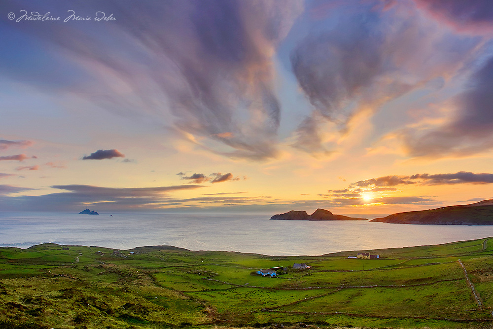 Sunset Ireland - Ring of Kerry - Scenic irish landscape view of atlantic coastline of southwest kerry during colourful sunset in the evening overlooking puffin island, the great skelligs and st. finians bay, County Kerry Ireland. Puffin Island and Skellig Michael and little skellig is a nature reserve / bs039 I love the Skelligs, ****** <br /> <br /> Visit &amp; browse through my Photography &amp; Art Gallery, located on the Wild Atlantic Way &amp; Skellig Ring between Waterville and Ballinskelligs (Skellig Coast R567), only 3 minutes from the main Ring of Kerry road.<br /> https://goo.gl/maps/syg6bd3KQtw<br /> <br /> ******<br /> <br /> Contact: 085 7803273 from an Irish mobile phone or +353 85 7803273 from an international mobile phone