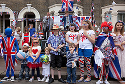 © Licensed to London News Pictures. 02/06/12. LONDON, UK. Children wait to be judged during a fancy dress competition held by the residents of Ravenscroft Road in Canning Town, East London, during a Jubilee street party. The Royal Jubilee celebrations. Great Britain is celebrating the 60th  anniversary of the countries Monarch HRH Queen Elizabeth II accession to the throne this weekend Photo credit : LNP