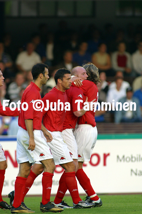 07.09.2002, Olympic Stadium, Helsinki, Finland..UEFA European Championship 2004 Qualifying match, Group 9, Finland v Wales..Ryan Giggs (left), Gary Speed, John Hartson and Robbie Savage celebrate the first goal for Wales, scored by Hartson on the 30th minute..©Juha Tamminen