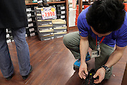sales person working on shoe shop Japan