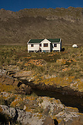 House built by WCS<br /> Steeple Jason Island. FALKLAND ISLANDS.<br /> The Jasons (Grand and Steeple) are a chain of islands 40 miles (64km) north and west off West Falkland towards Patagonia. Steeple is 6 by 1 mile (10Km by 1.6km) in size. From the coast the land rises steeply to a rocky ridge running along the length. <br /> This island has the largest Black-browed Albatross colony in the world with 113,000. The island is owned by WCS (Wildlife Conservation Society)