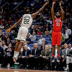 Dec 13, 2017; New Orleans, LA, USA; New Orleans Pelicans guard E'Twaun Moore (55) shoots over Milwaukee Bucks forward Khris Middleton (22) during the second half at the Smoothie King Center. The Pelicans defeated the Bucks 115-108. Mandatory Credit: Derick E. Hingle-USA TODAY Sports