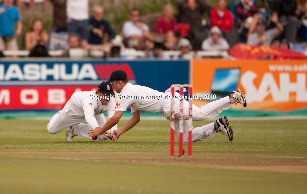 Graeme Swann (and Jonathan Trott) drop Graeme Smith on one during the third Test Match between South Africa and England at Newlands, Cape Town. Photograph © Graham Morris/cricketpix.com (Tel: +44 (0)20 8969 4192; Email: sales@cricketpix.com)