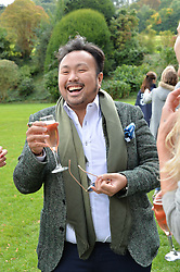 Ethan Koh at Young Guns raising money for the fight against breast cancer trough Cancer Research UK held at EJ Churchill Shooting School followed by lunch at West Wycombe Park, England. 23 September 2017.