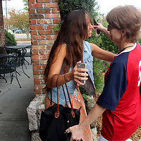 Rachael Gallelli, girlfriend of Michael Parrish hugs Parrish's Mother Joanne Parrish Saturday November 2, 2013 at Carrabba's Italian Grill in Wilmington, N.C. (Jason A. Frizzelle)