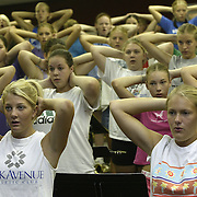 "MOC-Floyd Valley High School band members practice breathing with their hands over their heads at summer band camp in August.  ""Look around you,"" said band director Steve Connell on the first day of camp.  ""In this room ar the leaders of the school.  The most intelligent kids in the school... National Honor Society members... athletes.  I'm so blessed."""