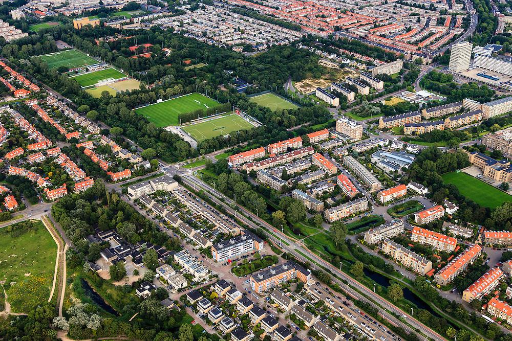 Nederland, Zuid-Holland, Den Haag, 15-07-2012; Machiel Vrijenhoeklaan overgaand in de Sportlaan. Rechts van twee lanen, met bouwblokken van flats en sportvelden, dede 'Atlantikwall strook'. In dit gebied is tijdens de Tweede Wereldoorlog de bevolking geëvacueerd en de bebouwing ontruimd en/of gesloopt ivm aanleg tankgracht..On both sides of the Sportlaan the Atlantic Wall strip. During the Second World War, the population of this area was evacuated and some of the buildings were demolished in order to build a antitank ditch...QQQ.luchtfoto (toeslag), aerial photo (additional fee required).foto/photo Siebe Swart