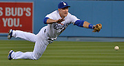 Los Angeles Dodgers second baseman Chase Utley #26 dives, but can not get the handle on this ball hit by Reds Brandon Phillips in the 4th inning. The Los Angeles Dodgers played the Cincinnati Reds at Dodger Stadium in Los Angeles , CA.  May 25, 2016. (Photo by John McCoy/Southern California News Group
