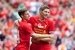 03.08.2013, Anfield Stadion, Liverpool, ENG, Testspiel, Liverpool FC vs Olympiakos CFP, im Bild Liverpool's Joe Allen celebrates scoring the first goal against Olympiakos CFP with team-mate captain Steven Gerrard during a preseason friendly match at Anfield during the friendly Match between Liverpool FC and Olympiakos CFP at the Anfield Stadion, Liverpool, England on 2013/08/03. EXPA Pictures © 2013, PhotoCredit: EXPA/ Propagandaphoto/ David Rawcliffe<br /> <br /> ***** ATTENTION - OUT OF ENG, GBR, UK *****