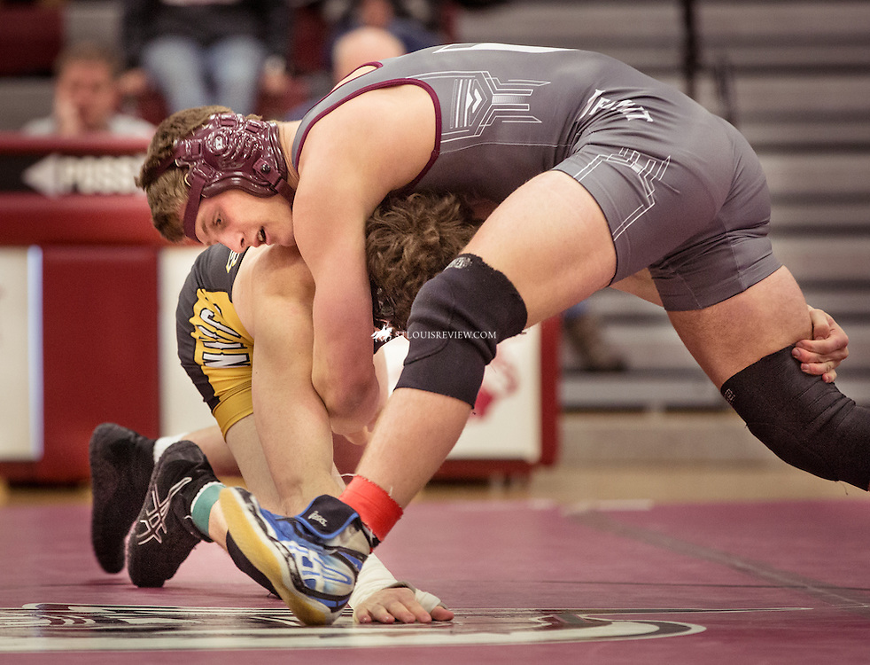 Lisa Johnston | lisajohnston@archstl.org | @aeternusphoto DeSmet's Sean Christman battled Vianney's Michael Tonini in the 170lb match that resulted in a pin and win for Christman. DeSmet Jesuit High School Spartans won their wrestling match 39-26 over St. John Vianney's Griffins. This was the first time in five years they have seen victory over their rival.