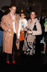Left to right, CORA SHEIBANI, her daughter ARYANS and SHANNON de BOISSARD at a party in aid of CLIC Sargent the childrens cancer charity to celebrate the publication of Beautiful Christmas Cards by Alexandra Adami hsted by Hendrik teNeues and Allegra Hicks at Allegra Hicks, 28 Cadoan Square, London on 12th October 2005.<br />
