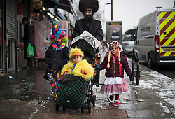 © Licensed to London News Pictures. 01/03/2018. London, UK. Orthodox Jewish children in fancy dress celebrate the festival of Purim on the streets of Stamford Hill in north London on March 1, 2018. Purim celebrates the miraculous salvation of the Jews from a genocidal plot in ancient Persia, an event documented in the Book of Esther. Traditionally the jewish community wear fancy dress and exchange reciprocal gifts of food and drink. Photo credit: Ben Cawthra/LNP