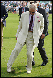 Image ©Licensed to i-Images Picture Agency. 26/07/2014. Windsor, United Kingdom. Prince Charles treading at half time during the Coronation Cup at Guards Polo Club, Windsor Great Park Picture by Andrew Parsons / i-Images