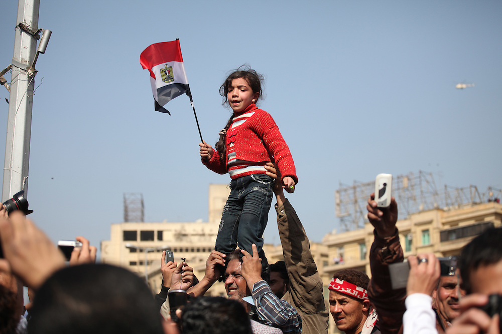A young girl leads protesters in chants against Mubarak.