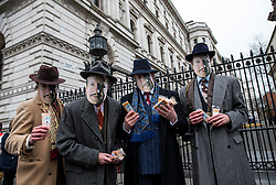 © Licensed to London News Pictures. 19/02/2016. London, UK. Leave.EU and the Democracy Movement protestors wearing David Cameron masks, holding fudge, dressed as 'Dodgy Dave' gather near Parliament and Downing Street as the Prime Minister David Cameron seeks reform of the United Kingdom's EU membership. Photo credit: Peter Macdiarmid/LNP