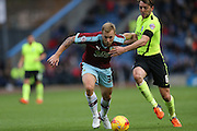 Burnley midfielder Scott Arfield (37) and Brighton central midfielder, Dale Stephens (6) during the Sky Bet Championship match between Burnley and Brighton and Hove Albion at Turf Moor, Burnley, England on 22 November 2015.