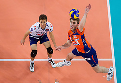 Ales Fabjan of ACH and Uros Kovacevic of ACH during volleyball match between ACH Volley and Lube Banca Marche Macerata (ITA) in 5th Leg of Pool D of 2013 CEV Champions League on December 5, 2012 in Arena Stozice, Ljubljana, Slovenia. ACH defeated Macerata 3-1. (Photo By Vid Ponikvar / Sportida)