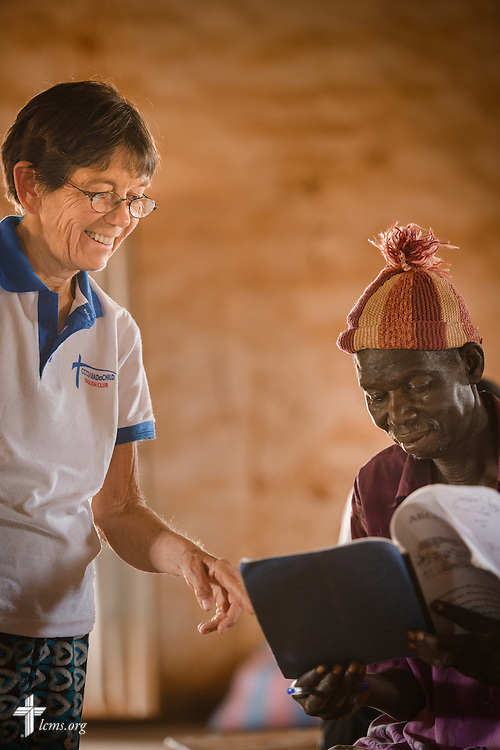 Valerie Stonebreaker, LCMS missionary, helps a man during a literacy project class at the Lutheran Church of Togo in Kpierik on Tuesday, Feb. 14, 2017, in Kpierik, Togo. LCMS Communications/Erik M. Lunsford