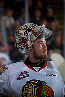 KELOWNA, BC - OCTOBER 20:  Cole Kehler #31 of the Portland Winterhawks stands at the bench with his mask up during a time out against the Kelowna Rockets at Prospera Place on October 20, 2017 in Kelowna, Canada. (Photo by Marissa Baecker/Getty Images)