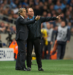 MANCHESTER, ENGLAND - Wednesday, September 14, 2011: Manchester City manager Roberto Mancini speaks with assistant David Platt during the UEFA Champions League Group A match at the City of Manchester Stadium. (Photo by Chris Brunskill/Propaganda)