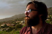 Garrett Ross, a film actor in his late twenties, takes in the view at Sandiago's Mexican Grill. The tequila bar sits at the upper end of Tramway Road overlooking the city of Albuquerque, New Mexico.