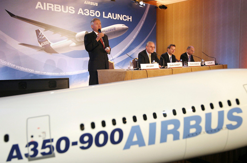 From left to right: John Leahy, Chief Commercial Officer, Airbus, speaking,  Gustav Humbert, President and CEO, Airbus, Charles Champion, COO, Airbus, Tom Williams, EVP Programmes, Airbus, at a press conference in Paris, France, Friday, October 7, 2005. <br /> Client: Bloomberg News