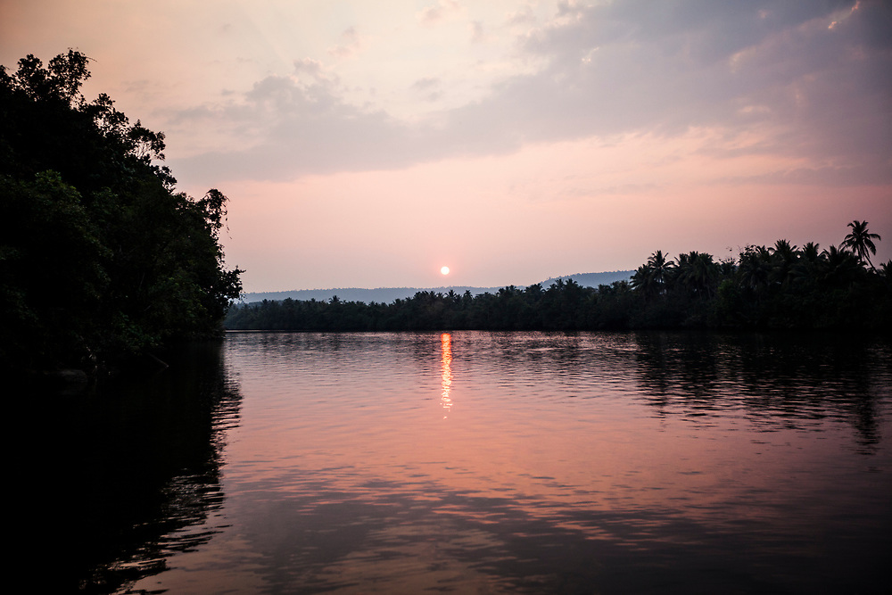 The sun sets over the Tatai river in Koh Kong, Cambodia.