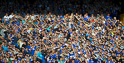 LIVERPOOL, ENGLAND - Sunday, September 20, 2009: Everton supporters shield their eyes from the sun during the Premiership match at Goodison Park. (Pic by David Rawcliffe/Propaganda)