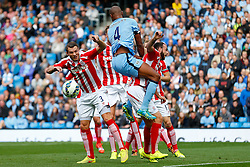 Erik Pieters of Stoke and Vincent Kompany of Manchester City compete in the air - Photo mandatory by-line: Rogan Thomson/JMP - 07966 386802 - 30/08/2014 - SPORT - FOOTBALL - Manchester, England - Etihad Stadium - Manchester City v Stoke City - Barclays Premier League.