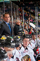KELOWNA, CANADA - OCTOBER 21: Associate coach Kyle Gustafson, stands next to equipment manger Mark Brennan on the bench against the Kelowna Rockets on October 21, 2017 at Prospera Place in Kelowna, British Columbia, Canada.  (Photo by Marissa Baecker/Shoot the Breeze)  *** Local Caption ***