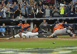 October 18, 2017 - Bronx, NY, USA - The New York Yankees' Brett Gardner, left, slides home safely on a double by Aaron Judge in the third inning, beating the throw to Houston Astros catcher Brian McCann in Game 5 of the American League Championship Series at Yankee Stadium in New York on Wednesday, Oct. 18, 2017. (Credit Image: © Howard Simmons/TNS via ZUMA Wire)
