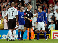 Photo: Daniel Hambury.<br /> Fulham v Everton. The Barclays Premiership.<br /> 27/08/2005.<br /> Everton's Phil Neville is hsown the red card by referee Mike Riley.