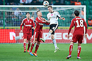 (L) Wisla's Lukasz Gargula fights for the ball with (R) Legia's Ondrej Duda during T-Mobile ExtraLeague soccer match between Legia Warsaw and Wisla Krakow in Warsaw, Poland.<br /> <br /> Poland, Warsaw, March 15, 2015<br /> <br /> Picture also available in RAW (NEF) or TIFF format on special request.<br /> <br /> For editorial use only. Any commercial or promotional use requires permission.<br /> <br /> Mandatory credit:<br /> Photo by © Adam Nurkiewicz / Mediasport