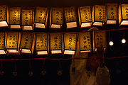 A shrine worker hangs a new lantern during the Mitama matsuri at the controversial Yasukuni Shrine in Kudanshita, Tokyo, Japan. Friday July 14th 2017. The Mitama Matsuri is one of Japan's largest Obon festivals with over 300,000 visiting the shrine to pay respect to ancestors during the 4 days it lasts. Obon is festival of remembrance for ancestors who are believed to come back from the other world and visit the living at this time. Yasukuni Shrine, which houses the spirits of the Japanese war dead, celebrates these spirits with 30,00 yellow lanterns and mikoshi parades and traditional dancing. The festivals runs from July 13th to 16th.