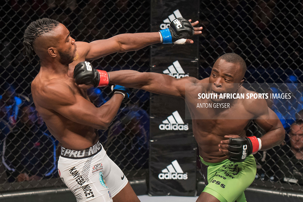 JOHANNESBURG, SOUTH AFRICA - MAY 13: (R-L) Rob Simbowe punches Anicet Kanyeba during EFC 59 Fight Night at Carnival City on May 13, 2017 in Johannesburg, South Africa. (Photo by Anton Geyser/EFC Worldwide/Gallo Images)