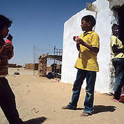 Refugee children eating icecream at the refugee camps of Tindouf, Algeria.