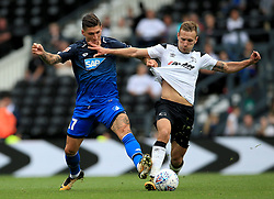 Derby County's Andreas Weimann (Right) and TSG 1899 Hoffenheim's Steven Zuber battles for the ball.