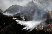 A helicopter makes a water drop on the hills in the Newhall Pass in this view from the air looking down at the Sayre fire in Sylmar, Ca 11/15/2008. Photo by John McCoy/staff photographer