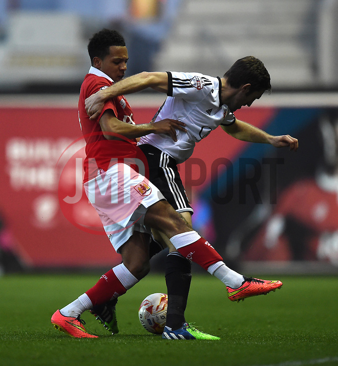 Bristol City's Korey Smith tussles with Swindon Town's Sam Ricketts - Photo mandatory by-line: Paul Knight/JMP - Mobile: 07966 386802 - 07/04/2015 - SPORT - Football - Bristol - Ashton Gate Stadium - Bristol City v Swindon Town - Sky Bet League One