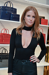 MILLIE MACKINTOSH at the launch of the new Giusepe Zanotti store in Conduit Street, London on 26th October 2016.
