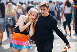 © Licensed to London News Pictures. 29/08/2016. London, UK. A drunk reveller helped by her friend on the second day of Notting Hill Carnival in west London, Monday 29 August 2016. Photo credit: Tolga Akmen/LNP