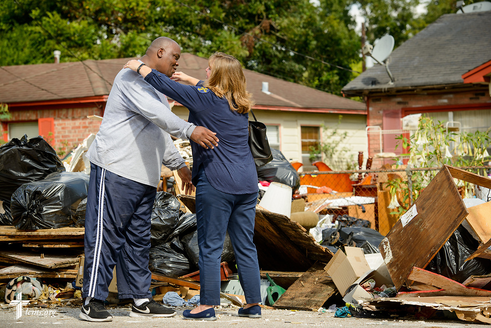 Deaconess Kim Schave hugs a man who was helping clean out his parents' house which was damaged by Hurricane Harvey on Tuesday, Sept. 26, 2017, in Houston. LCMS Communications/Erik M. Lunsford
