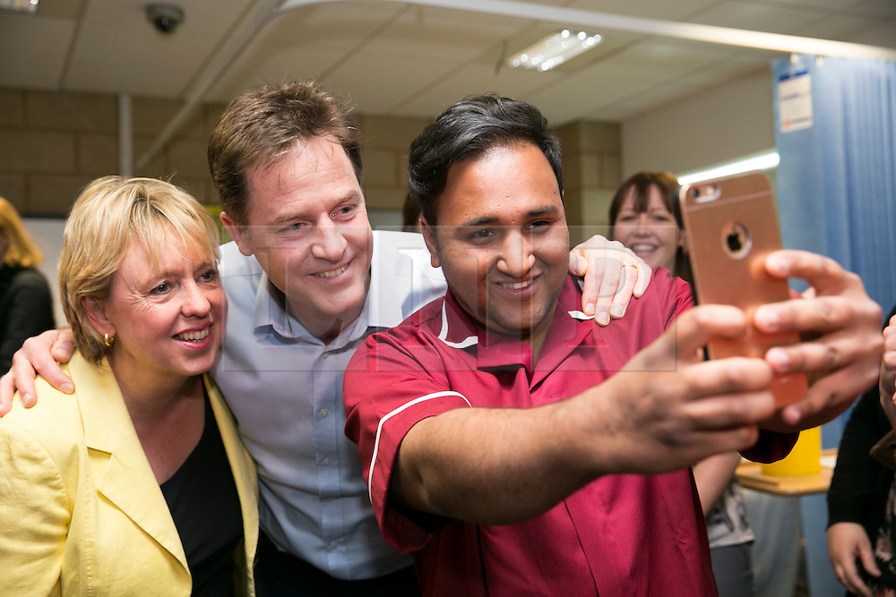 © Licensed to London News Pictures. 01/05/2015. Solihull, West Midlands, UK. Deputy Prime Minister Nick Clegg visiting Solihull College to meet Health and Social Care students. Pictured, Nick Clegg has a selfie with Fahad Bhimji and Loreley Burt. Photo credit : Dave Warren/LNP